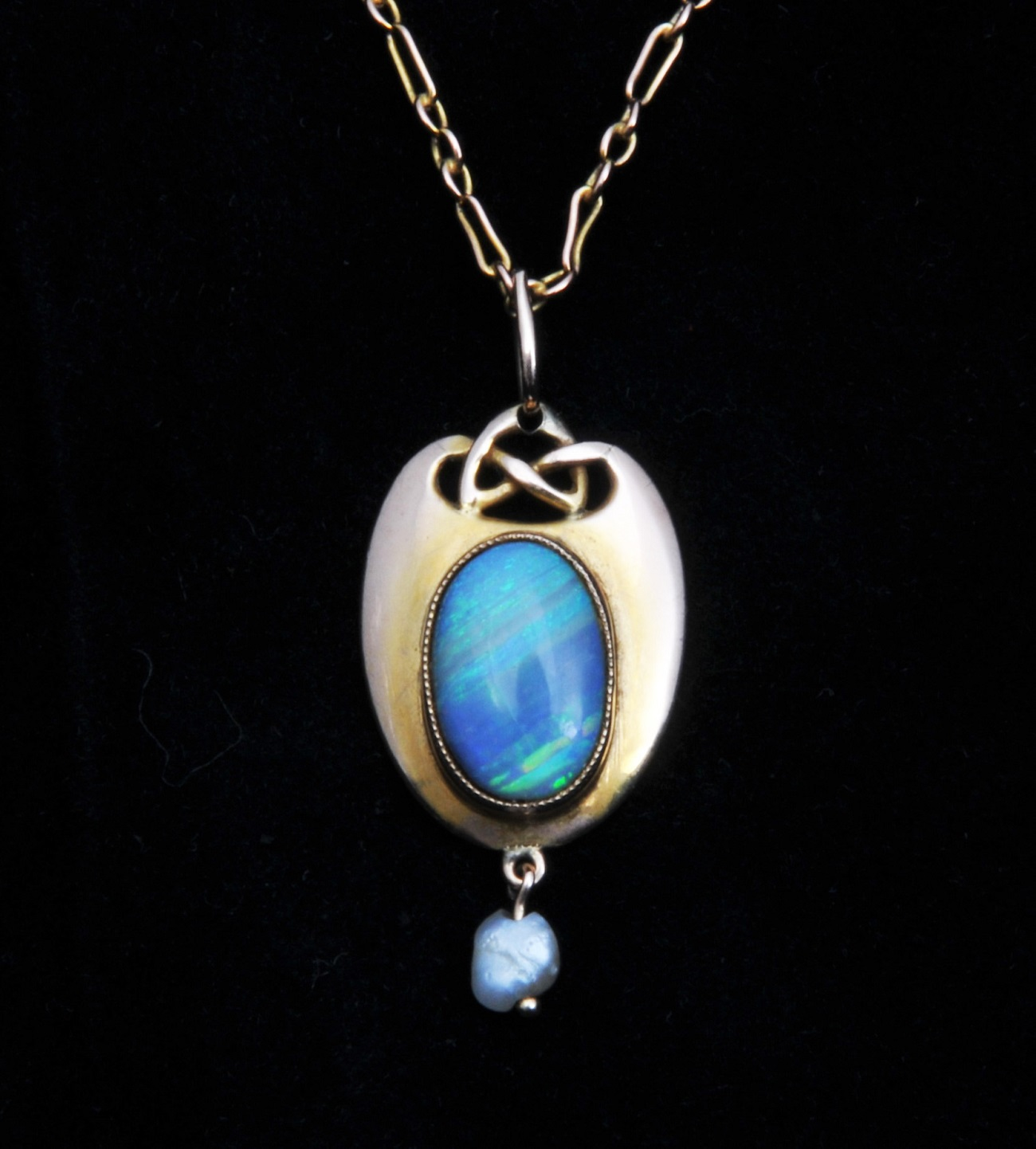 Archibald Knox style opal pendant