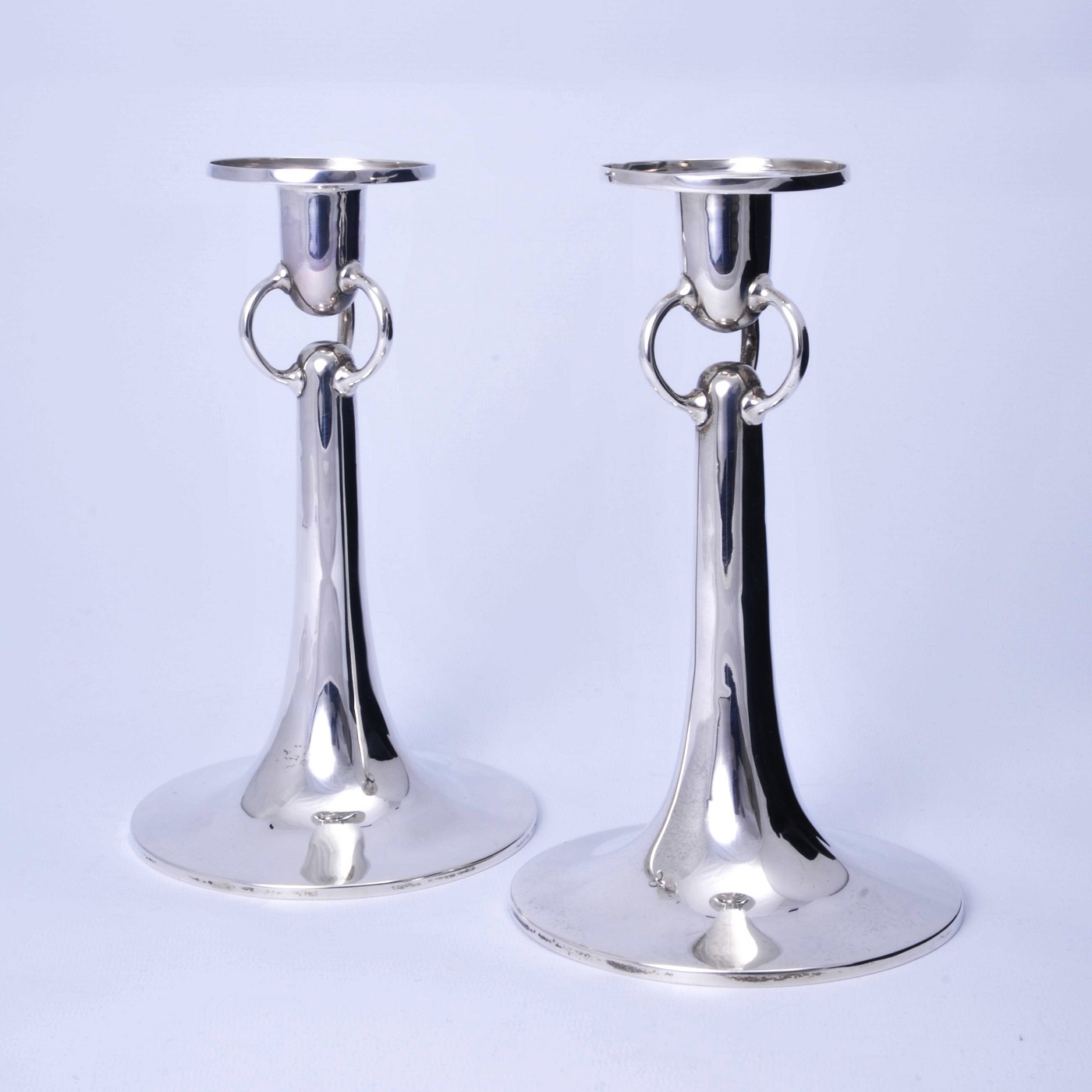 Arts and crafts modernist silver candlesticks