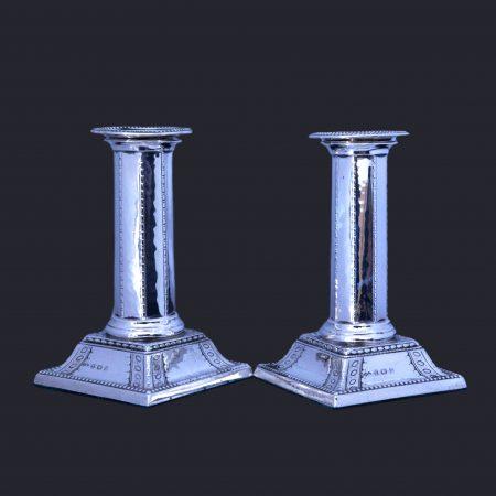 Liberty cymric candlesticks, bernardd cuzner silver